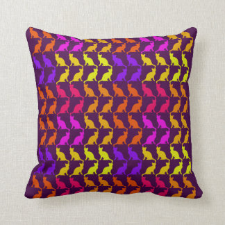 Multiple colorful cats on purple throw pillows