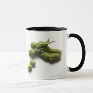 multiple green edamame beans with pea pod broken mug