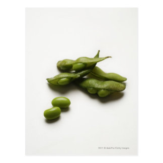 multiple green edamame beans with pea pod broken postcard