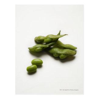 multiple green edamame beans with pea pod broken postcard