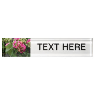 multiple pink flowers with bee neat insect flower desk name plate