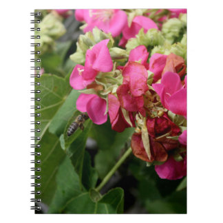 multiple pink flowers with bee neat insect flower notebook