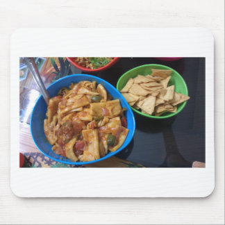 Multiple snacks ready for eating, in small plastic mouse pad
