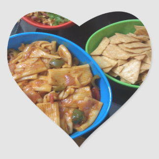 Multiple snacks ready for eating, in small plastic heart sticker