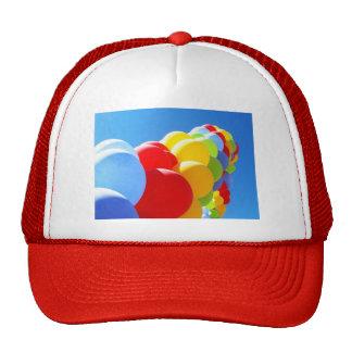 Mundo colorido del globo gorras