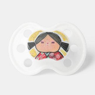 Muñeca de Kokeshi Chupetes