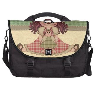 Muñeca de trapo adorable del país bolsas de portatil
