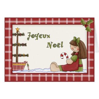 Muñeca de trapo caprichosa del navidad en lengua f felicitación