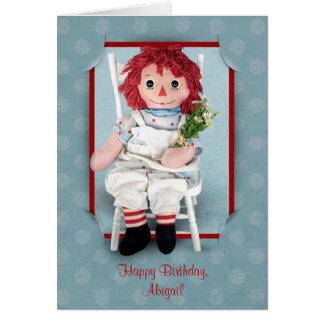 Muñeca de trapo vieja con las margaritas tarjeta de felicitación