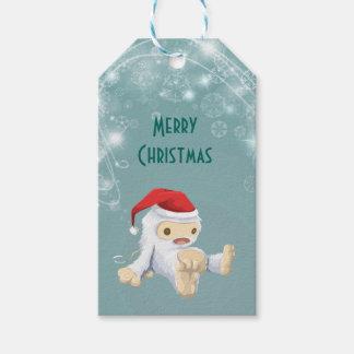 Muñeca de Yeti del navidad que lleva un gorra de Etiquetas Para Regalos
