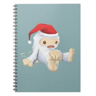 Muñeca de Yeti del navidad que lleva un gorra de Note Book