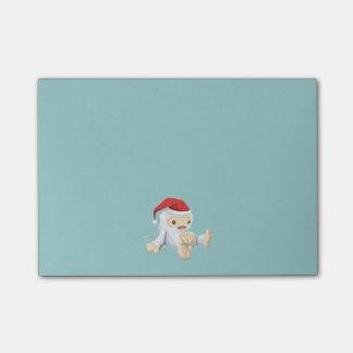 Muñeca de Yeti del navidad que lleva un gorra de Post-it® Nota