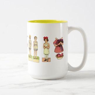 Muñecas de papel del vintage taza