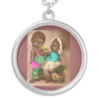 muñecas negras adorables de los años 20 RPPC en Colgante Redondo
