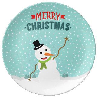 Muñeco de nieve caprichoso feliz el día de navidad plato de cerámica