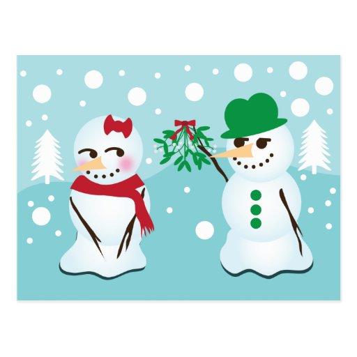 Muñeco de nieve con el muérdago que quiere un beso tarjetas postales