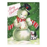 Muñeco de nieve con el perro tarjeta postal