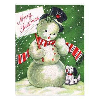 Muñeco de nieve con el perro postal