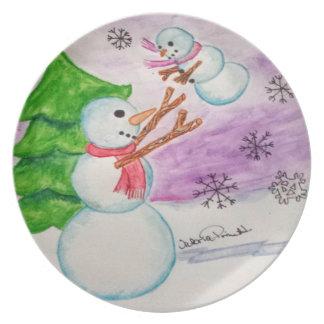 Muñeco de nieve con la placa del niño plato de cena