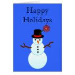 Muñeco de nieve con la tarjeta de felicitación de
