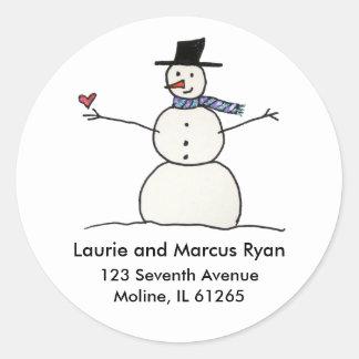 Muñeco de nieve con las etiquetas de dirección del
