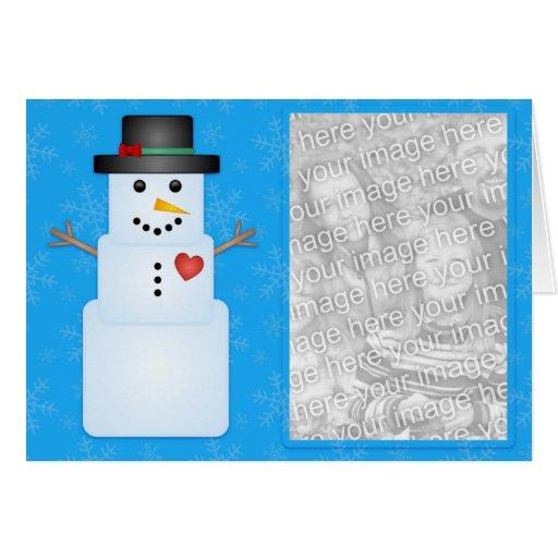 Muñeco de nieve cubicado con la tarjeta de la foto