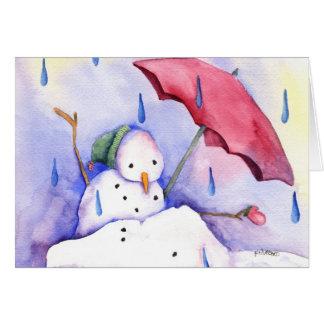 Muñeco de nieve de fusión con la tarjeta del parag