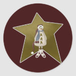 Muñeco de nieve del país con la estrella etiqueta