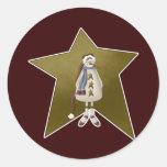 Muñeco de nieve del país con la estrella etiqueta redonda