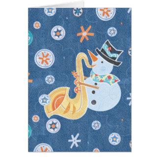 Muñeco de nieve del saxofón que hace música del tarjeta de felicitación