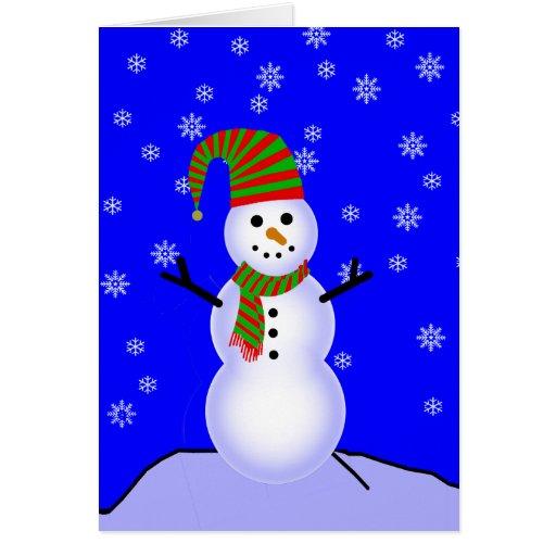 Muñeco de nieve en gorra rayado verde rojo y tarjeta de felicitación
