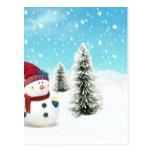 Muñeco de nieve en la nieve postales
