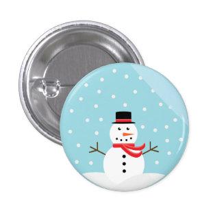 Muñeco de nieve en un botón del globo de la nieve pin