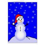Muñeco de nieve en un gorra de Santa Felicitaciones