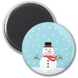 Muñeco de nieve en un imán del globo de la nieve -