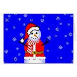 Muñeco de nieve en un juego de Santa con la bufand Felicitaciones