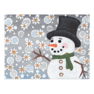 Muñeco de nieve en una nevada postal