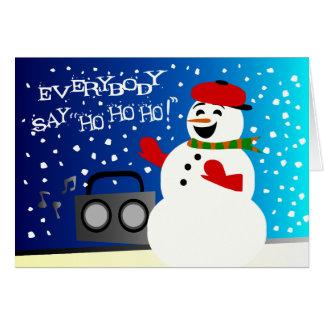 Muñeco de nieve enrrollado que golpea buenas fies tarjetón