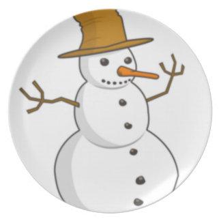 Muñeco de nieve feliz con un gorra plato de cena