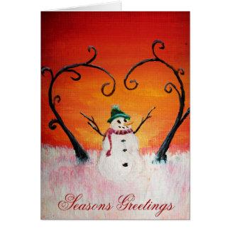 Muñeco de nieve feliz lindo en la puesta del sol - felicitacion