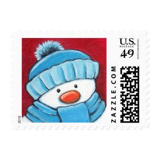 Muñeco de nieve festivo en el gorra y la bufanda sello