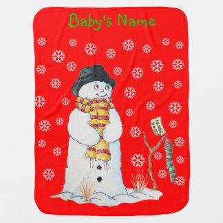 Muñeco de nieve lindo con el navidad que almacena  mantas de bebé