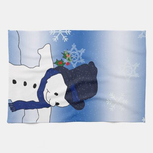 Muñeco de nieve patinador en azul toallas de cocina