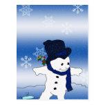 Muñeco de nieve patinador en azul postal