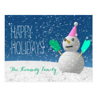 Muñeco de nieve que lleva las manoplas verdes tarjeta postal