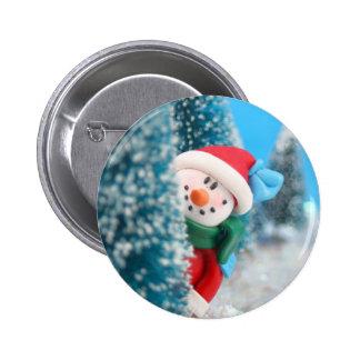 Muñeco de nieve que oculta o que mira a escondidas pins