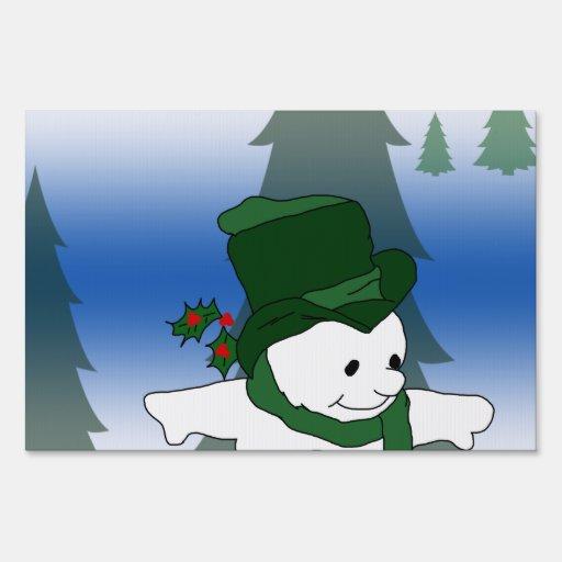 Muñeco de nieve que patina en verde letreros