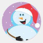 Muñeco de nieve redondo pegatina redonda