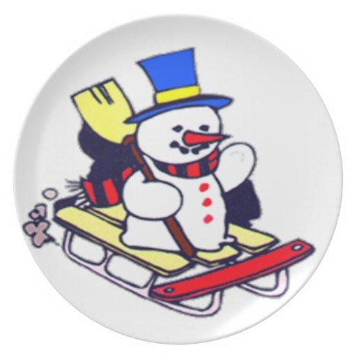 Muñeco de nieve Sledding Platos De Comidas