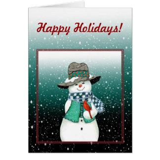 Muñeco de nieve sonriente, cardinal en una tarjeta